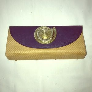 Navy clutch with gold shell detail